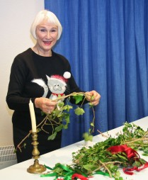 Talk and Community Activity Session - a visitor gets to grips with an ivy wreath at the Victorian Christmas Talk and Activity Session